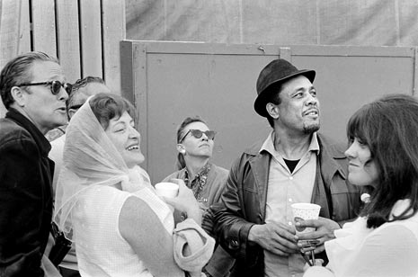 Charles Mingus with Ralph Gleason and Jean Gleason, Monterey Jazz Festival, 1964