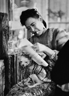 Billie Holiday with her dog, Pepi, at the Monterey Jazz Festival, 1958